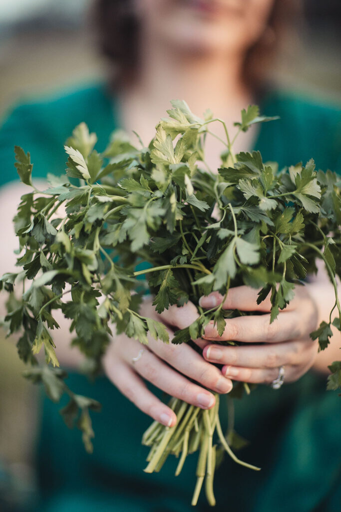 Are you an active or passive patient? Emily holding up posy of parsley.