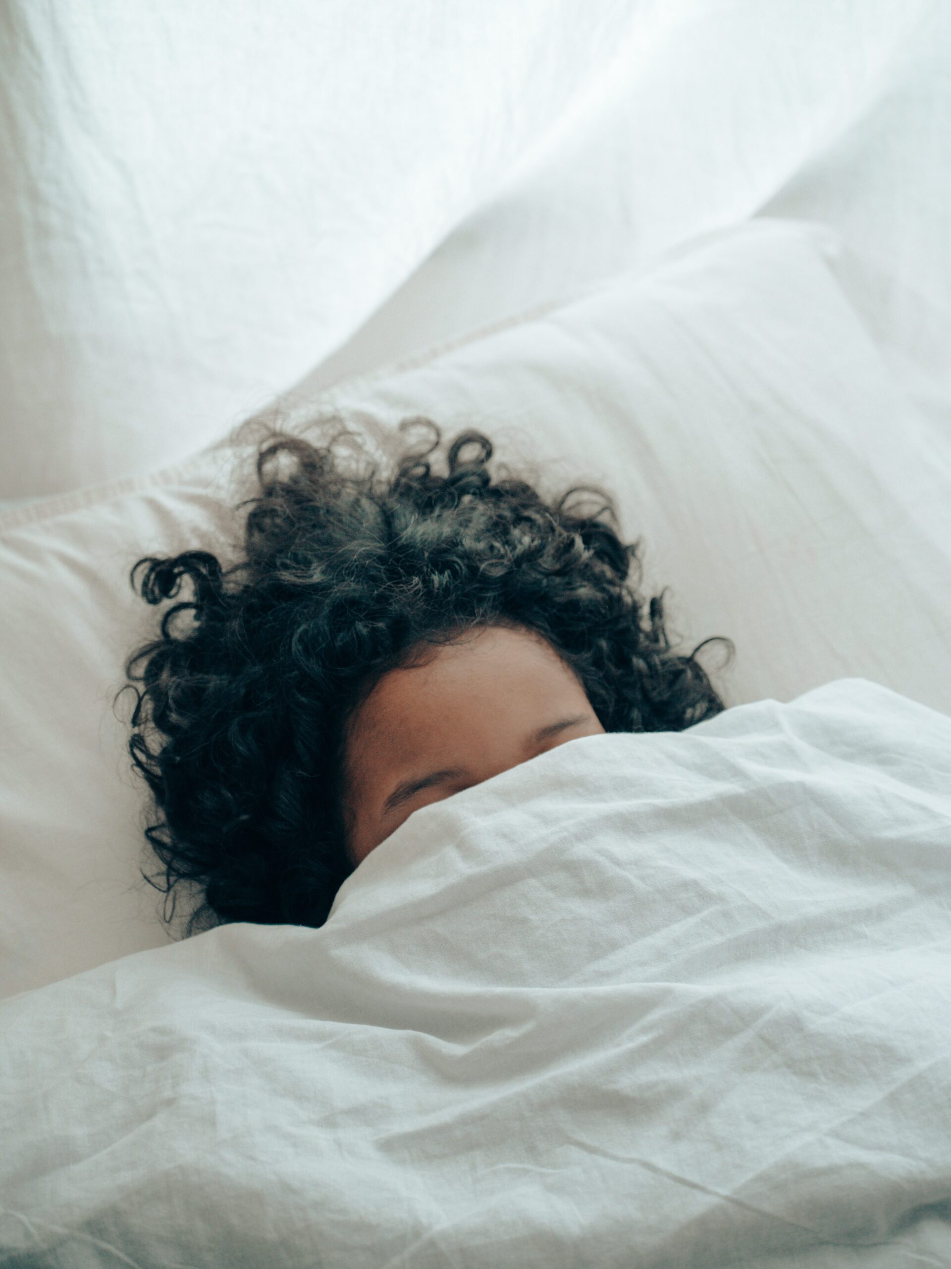 Hitting The Wall, girl sleeping under white covers